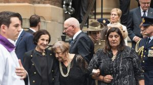 Marie Bashir stands with her family after the funeral service for her husband Sir Nicholas Shehadie.