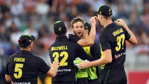 Andrew Tye celebrates after dismissing New Zealand's Mitchell Santner for a duck in the T20 final last night.