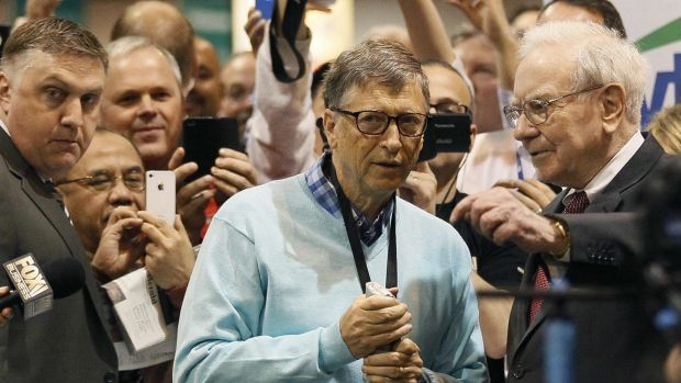 Friends in high places: Microsoft founder Bill Gates gets tips from his friend Warren Buffett.