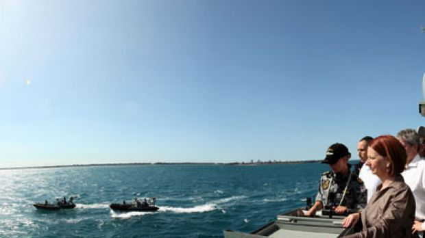 Prime Minister at the helm ...  Julia Gillard joins officers and crew aboard HMAS Broome in Darwin harbour yesterday for ...