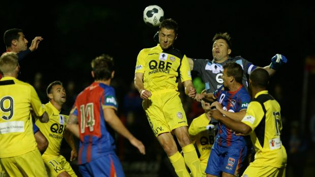 Heads up: Perth Glory player Dino Djulbic rises highest during his side's win over the Newcastle Jets.