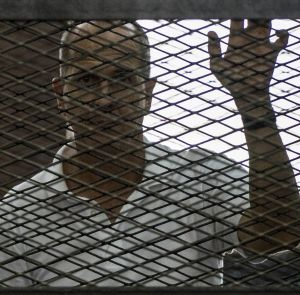 Peter Greste inside the defendants cage during his trial in June, 2014.