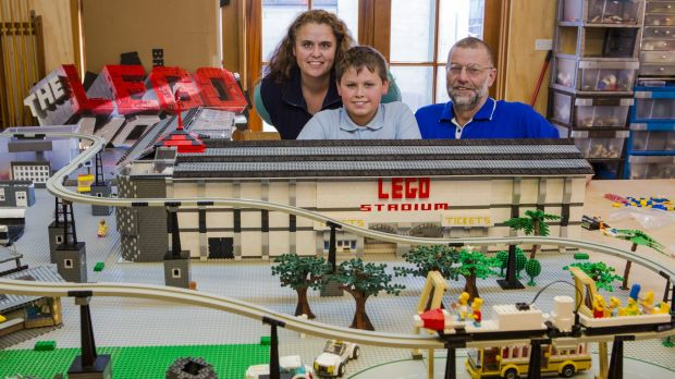 Mel Bezear, Anthony McLauchlan, and their son Oliver McLauchlan, 10, with some of the Lego that will be on display for ...