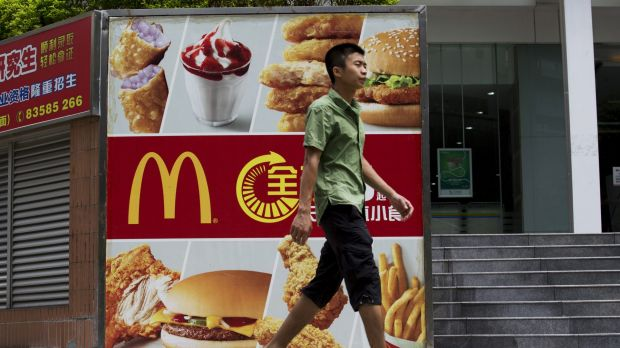A pedestrian walks past an advertisement for McDonald's in the Futian district of Shenzhen, China, where sales have been ...