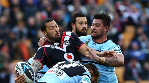 Shark attack: Feleti Mateo tries to get a pass away under all sorts of Cronulla pressure.