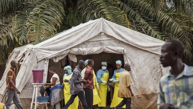 Health workers screen people for Ebola at Kenema Government Hospital, Sierra Leone.