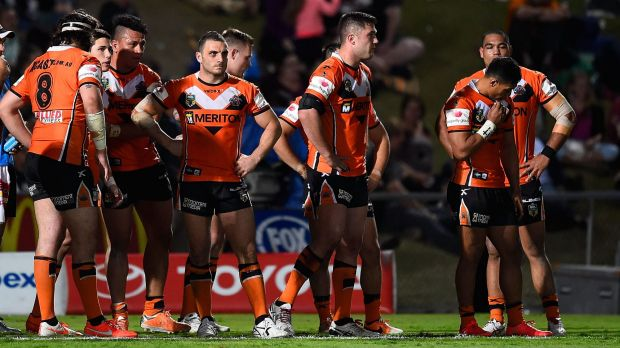 Dejected: Wests Tigers players stand in goal awaiting a conversion attempt after one of the Cowboys' 12 tries on ...