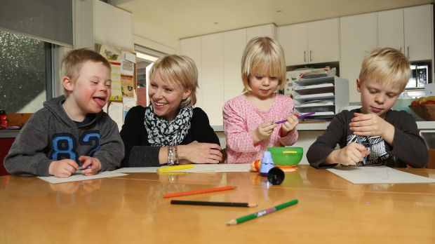 Abigail Elliott draws with her children Willem, left, Imogen and Fynley. The family has faced tough choices in finding ...