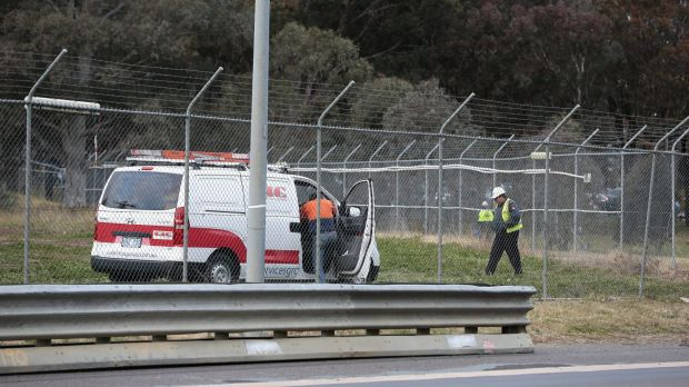Workers removing part of the fence at the new ASIO headquarters in Parkes.