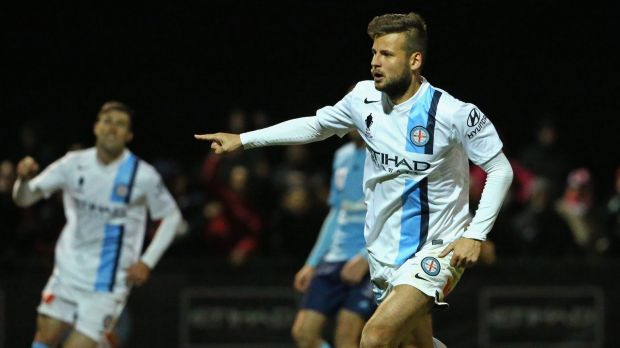 Party time: Melbourne City's Nick Kalmar celebrates a goal against Sydney FC.