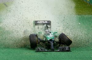 Early casualty: Kamui Kobayashi crashes on the first corner during this year's Melbourne Grand Prix.