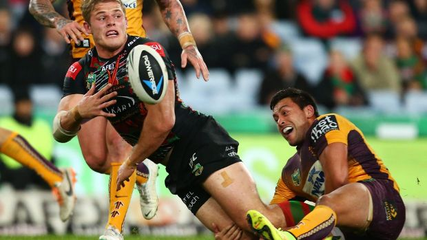 Tom Burgess gets the ball away in the tackle.