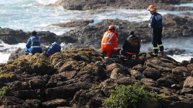 Emergency services search for a rock fisherman on Friday.