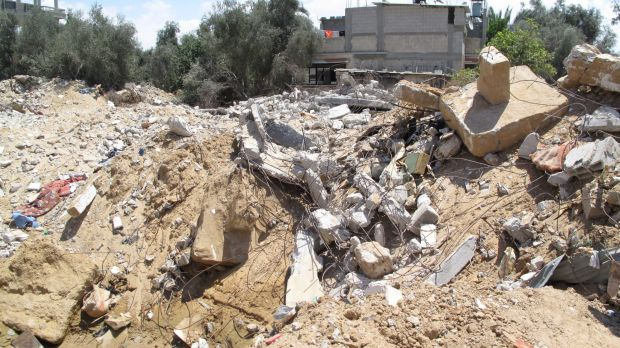 The remains of the Abu Jame family's three-storey apartment block destroyed in an airstrike, in which 26 people died.
