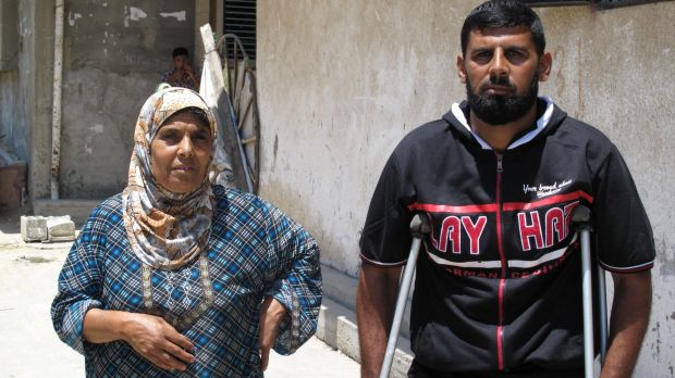 Basem Abu Jame, 31, with his sister. He is one of only three people who survived an airstrike on his house in Khan ...