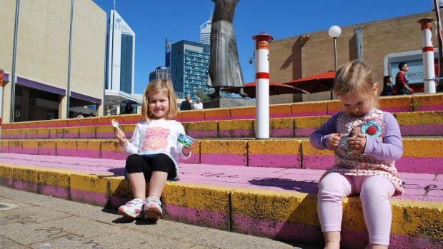 Zara (3) and Pippa (2) Harding enjoy the sunshine in the Perth Cultural Centre.