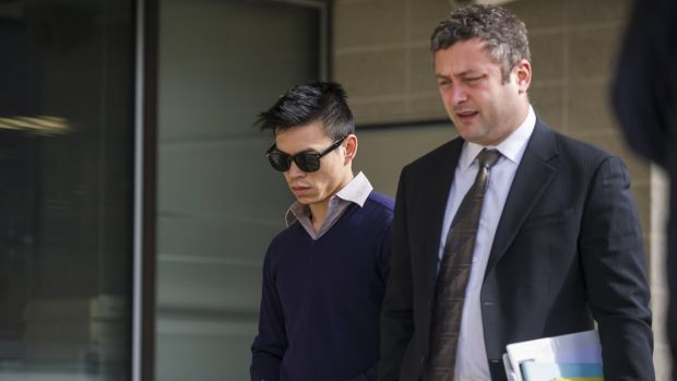 Stanley Hou, left, outside the ACT Magistrates Court in August with his lawyer Kamy Saeedi, right.