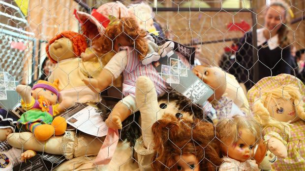 Children look at a cage filled with dolls inside  St John's Anglican Cathedral in Brisbane, representing the 895 child ...