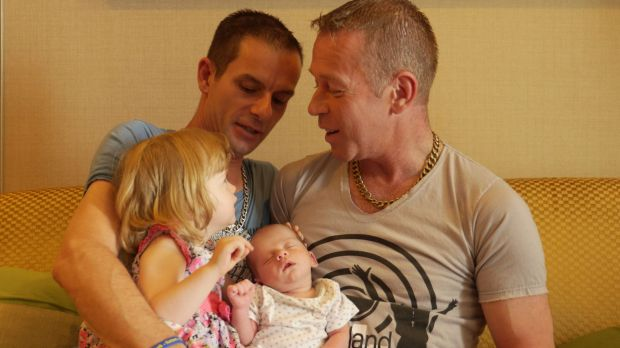James, left, with Steven and their newborn Rhyley and two-year-old daughter Aleisha, in Bangkok.