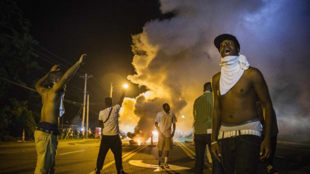 Demonstrators confront police during ongoing protests in reaction to the shooting of teenager Michael Brown.
