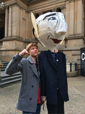 Student Tom Harman with an effigy of Prime Minister Tony Abbott at a rally against proposed changes to higher education,