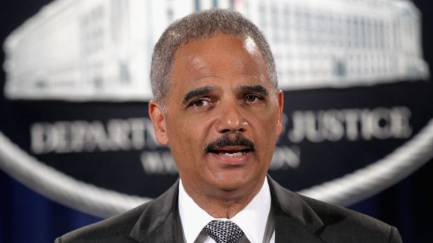 """US Attorney-General Eric Holder: """"Meaningful change is possible."""""""