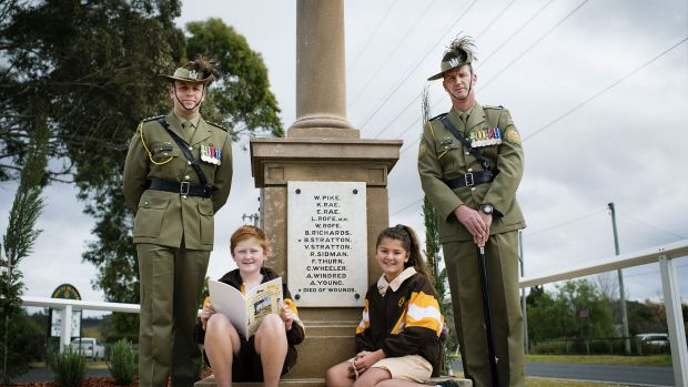 Lest we forget: Captain Nick Hornbuckle (left), Mount Hunter public school students Issac Latham and Chantel Wright and ...