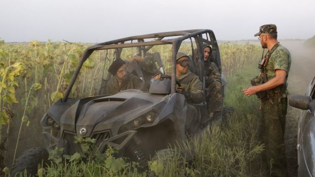 Pro-Russian rebels meet in a field near the village of Khryaschevatoye, in eastern Ukraine.