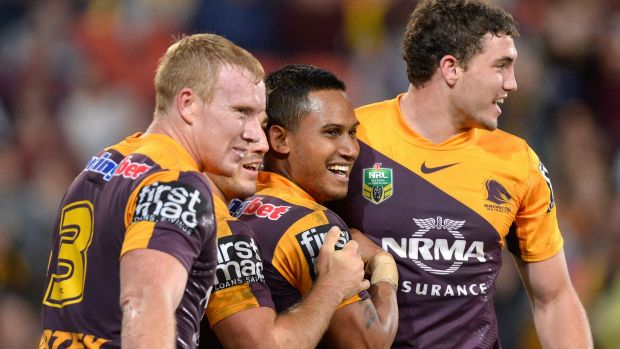 Broncos players congratulate Ben Barba (middle) on scoring a try against the Knights.