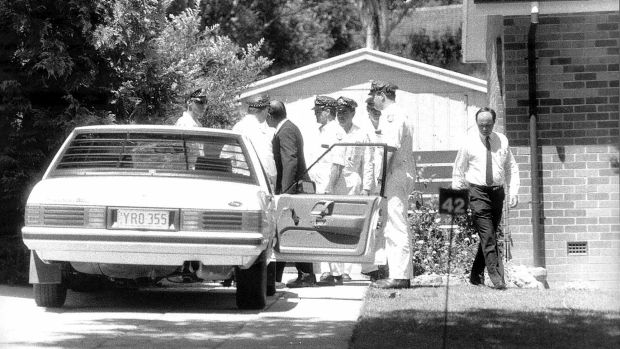 Detective Sergeant Bob Lehman and police with the car in which Assistant Commissioner Colin Winchester was shot in his ...