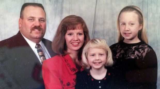 BEFORE: Cory Slagle with his family before he started using the Fitbit.
