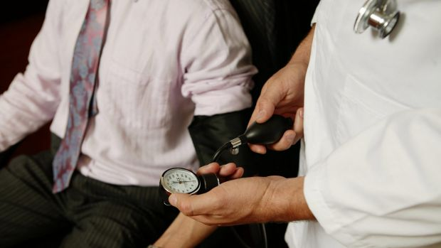 bloodpressure.jpg Doctor. Generic set up photo of a doctor taking a businessmans blood pressure. 5 June 2006. AFR Photo ...