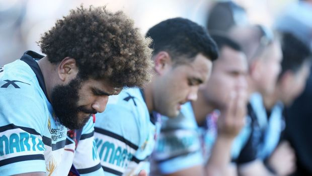 Junior Roqica of the Sharks looks dejected on the Sharks bench.