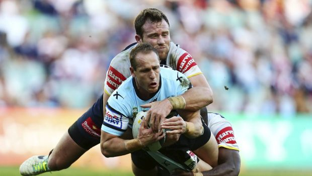 Jeff Robson of the Sharks is tackled by Cowboys Gavin Cooper and Robert Lui.