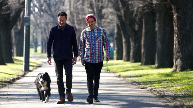 Jason Maling with his dog Fergus and Malcolm Whittaker, in Edinburgh Gardens in Fitzroy North.