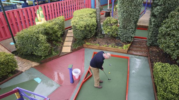 Tony Smith plays at the Ermington Putt Putt centre, which is under threat from a development proposal for 1000 units.