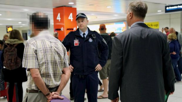 Former St Mary's Cathedral College principal David Standen is arrested at Sydney Airport.