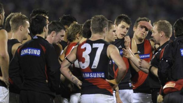 Essendon coach Matthew Knights addresses his players during his team's debilitating loss to Adelaide two weeks ago.
