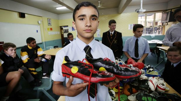 Helping out: Logan Aldridge,13, is donating his boots.