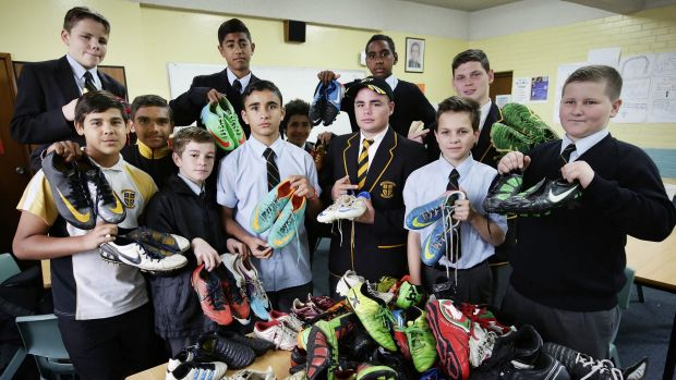Good cause: Students from Champagnat College with the footy boots that will go to indigenous communities.