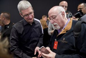 Tim Cook talks with Walt Mossberg at the launch of the iPhone 5 in 2012.