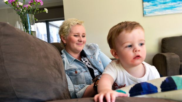 Caroline Weston, with son Ted, risked recurrent cancer.