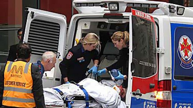The  injured man is rushed to hopsital after falling from an escalator at Southern Cross Station.