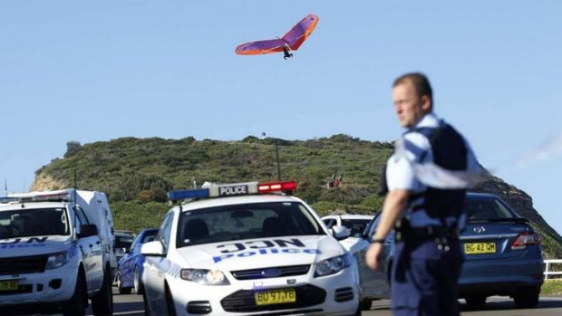 Other thrillseekers continue to hang-glide near the scene of a fatal crash in Newcastle on Sunday.