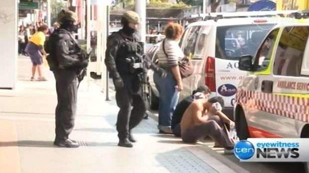 The scene in Cabramatta on Monday. Three men, including a suspended police officer, have been charged with robbery in ...