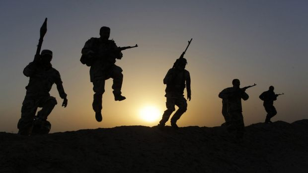 Shiite volunteers south of Baghdad secure the area against the predominantly Sunni militants from the Islamic State.