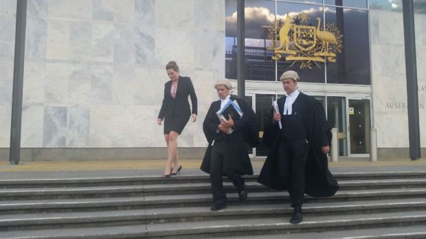 Prosecutors leave the ACT Supreme Court after the Vojneski verdict was handed down.