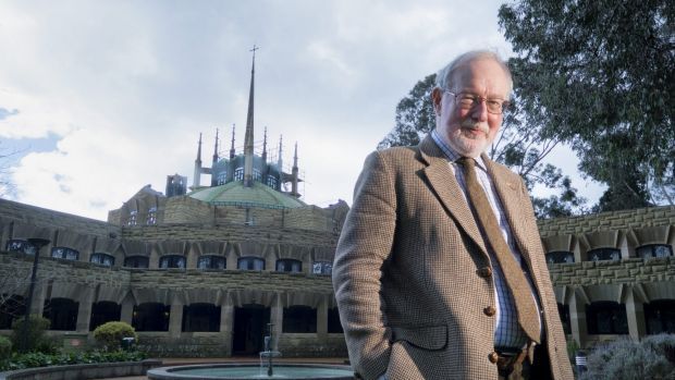 Conductor Richard Divall outside  Melbourne University's Newman College dome.
