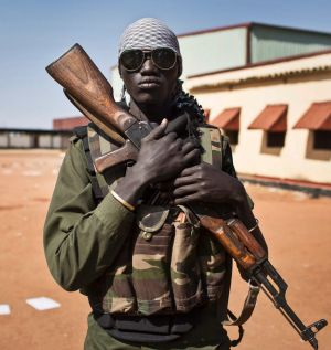 A South Sudanese government soldier in the town of Bentiu after it was recaptured from rebels in January this year.
