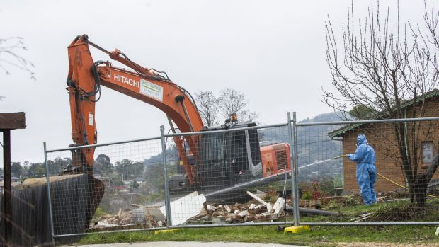 Workers demolish a Mr Fluffy home in Farrer.